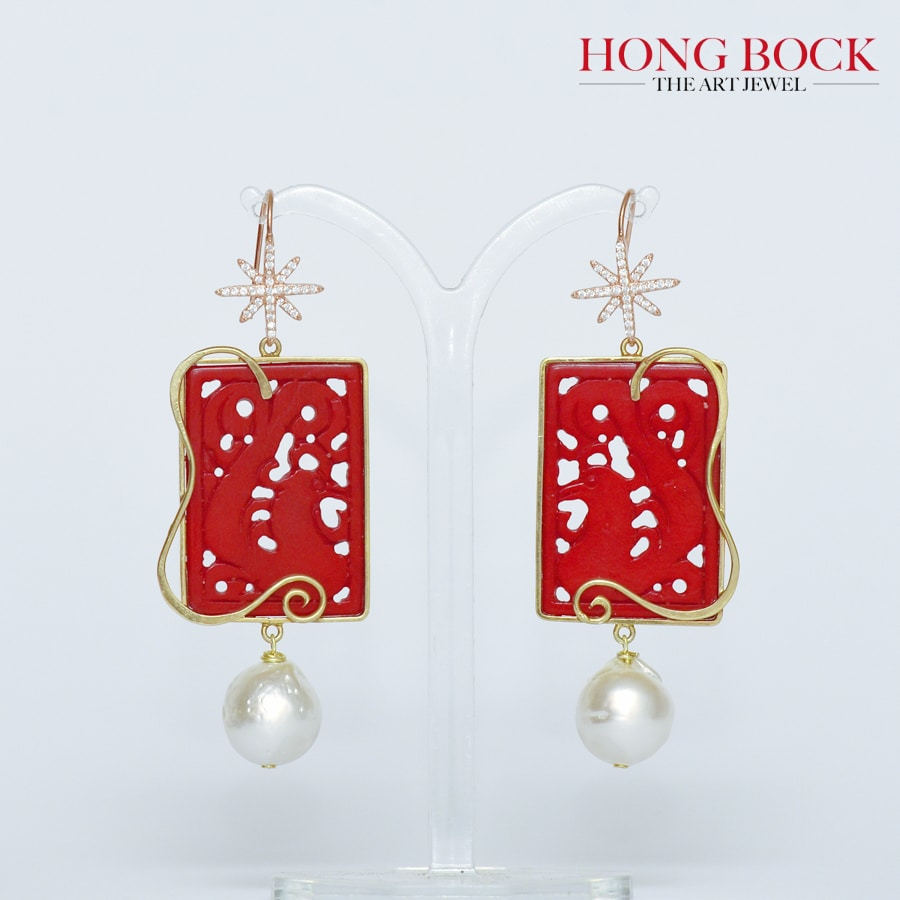 Design earrings made of handcarved coral with richly gilt craftwork-0